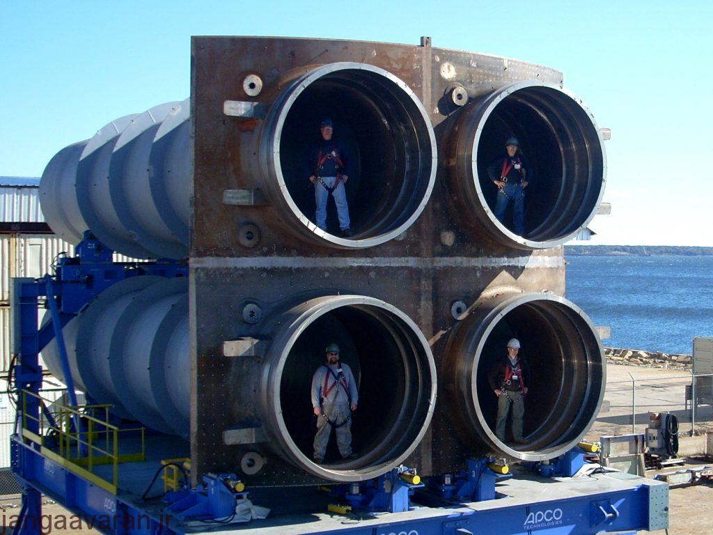 """Workers stand pose for a photo in the four-tube """"quad-pack"""". (U.S. Navy photo courtesy of General Dynamics Electric Boat/Released)"""