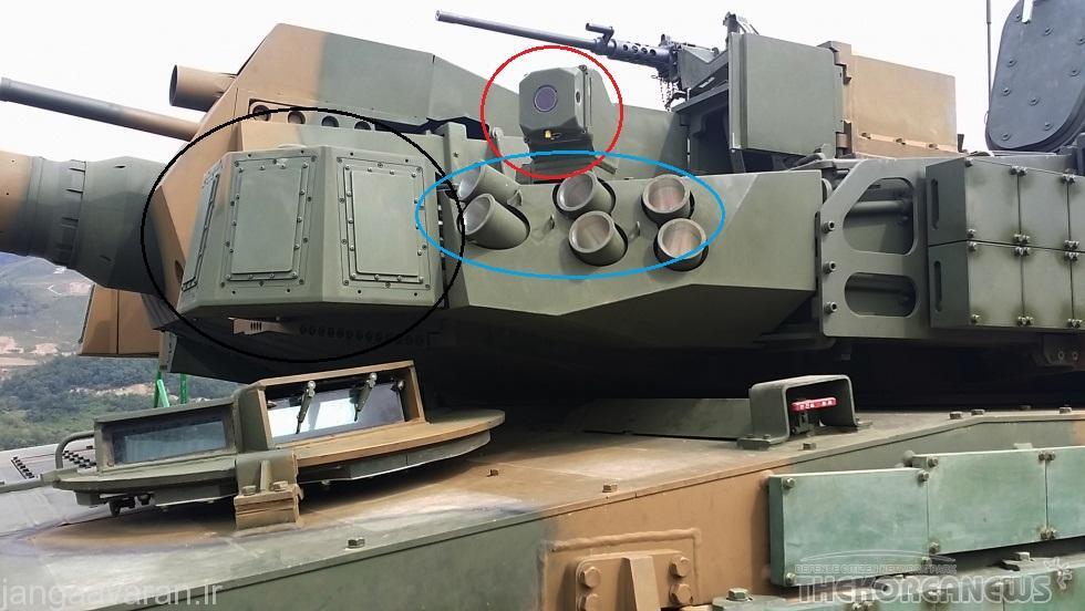در صتویر رادار سامانه دفاع فعال با دایره مشکی، سامانه اپتیک حرارتی با دایره قرمز و نارنجک انداز دود زا با دایره ابی مشخص شده است