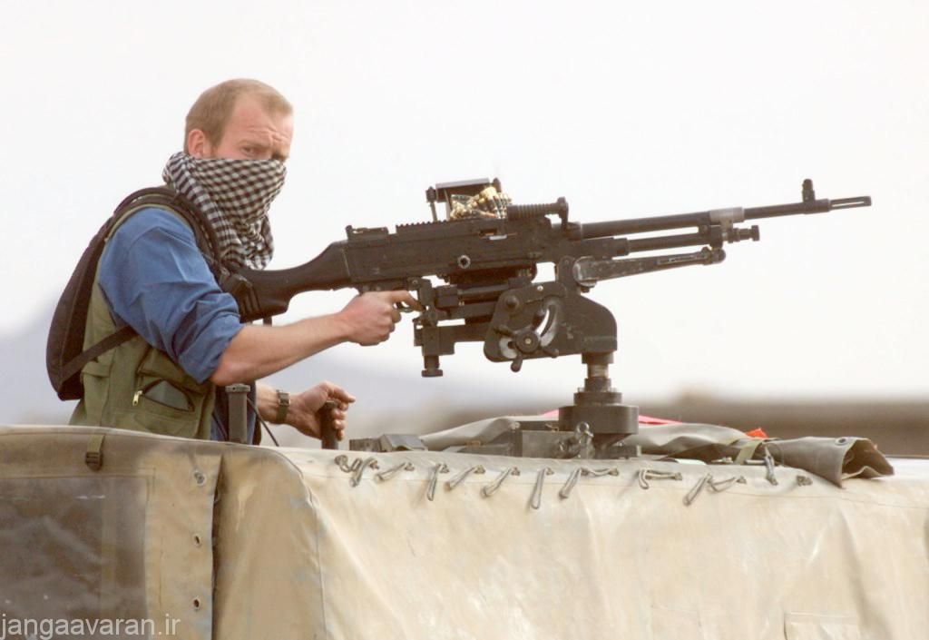 A British special forces operative stands guard on the southern outskirt of Kandahar airport Wednesday Dec. 12, 2001, British and U.S. special forces are seen operating around Kandahar's airport. (AP Photo/Jerome Delay)