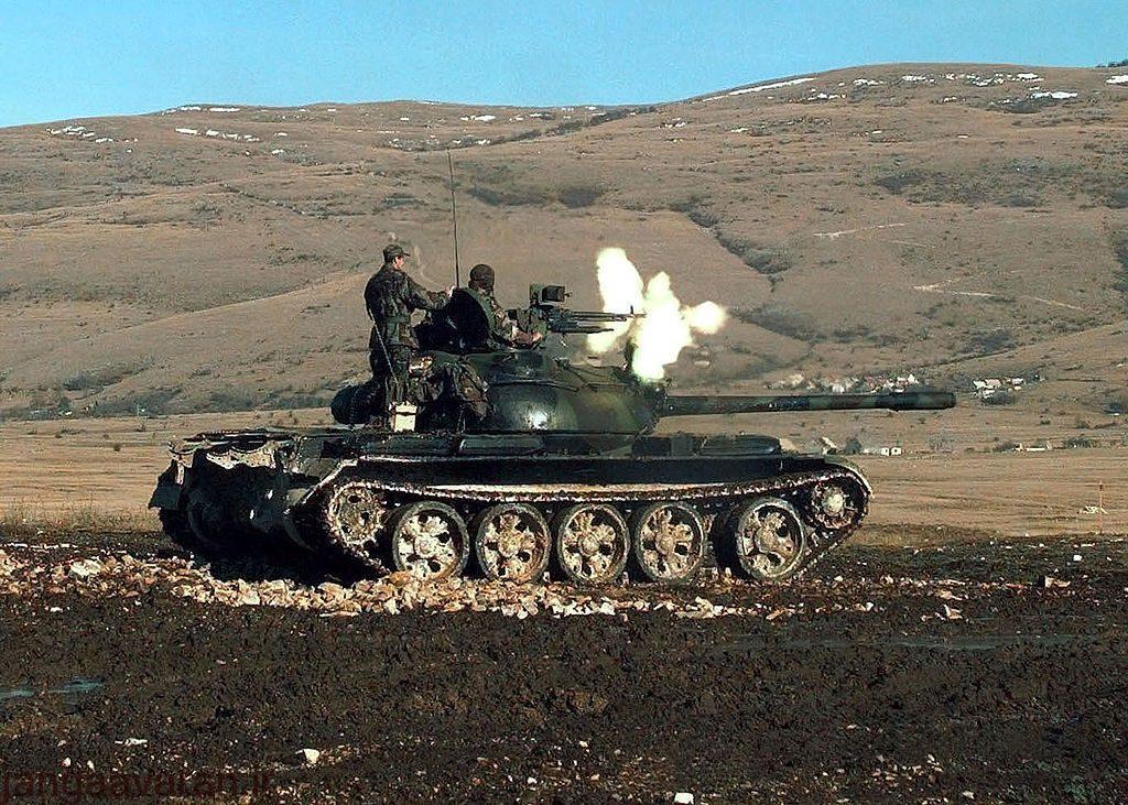 1024px-HVO_Army_T-55_Glamoc_firing_MG
