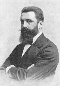 تئودور هرتزل فعال سیاسی و روزنامه نگار اتریشی-یهودی. او سعی کرد با راضی کردن عبدالحمید دوم مجوز مهاجرت قانونی یهودیان به فلسطین را بگیرد